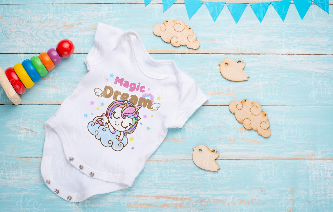 White baby jumpsuit with a unicorn.