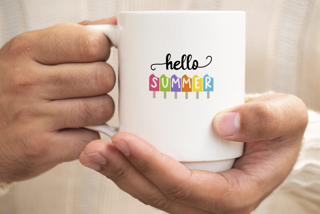 A white big cup with colorful lettering.