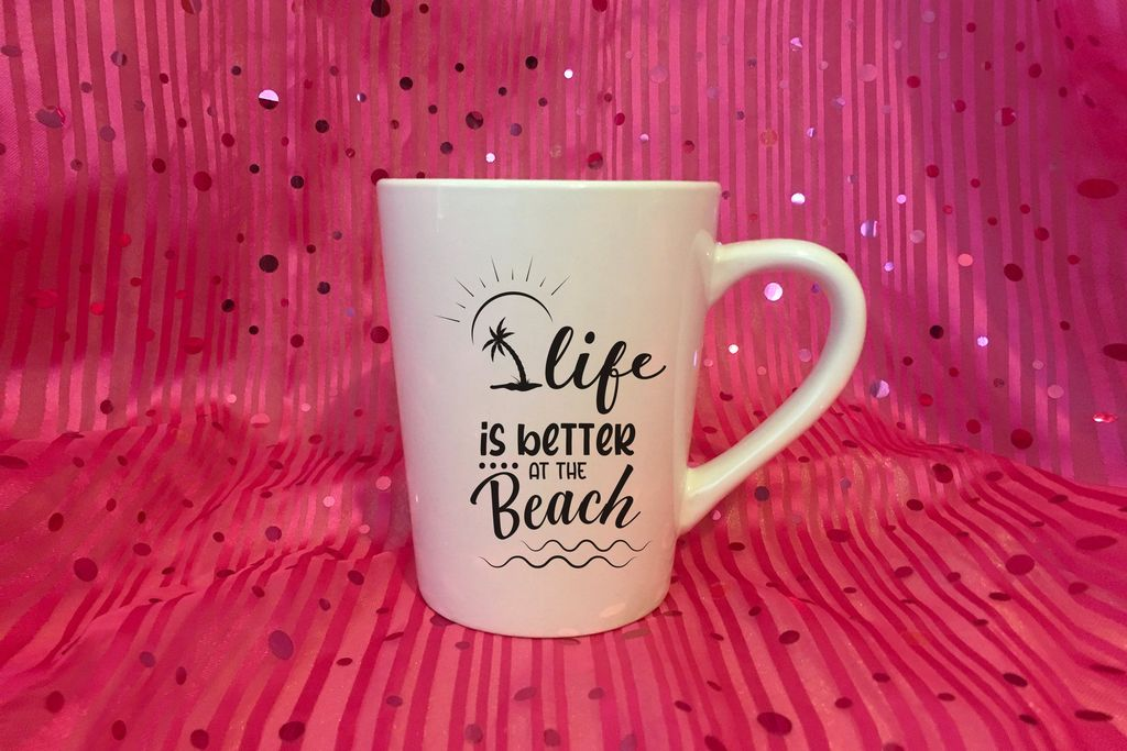 Glamorous pink fabric with a white cup with the beach word on it.