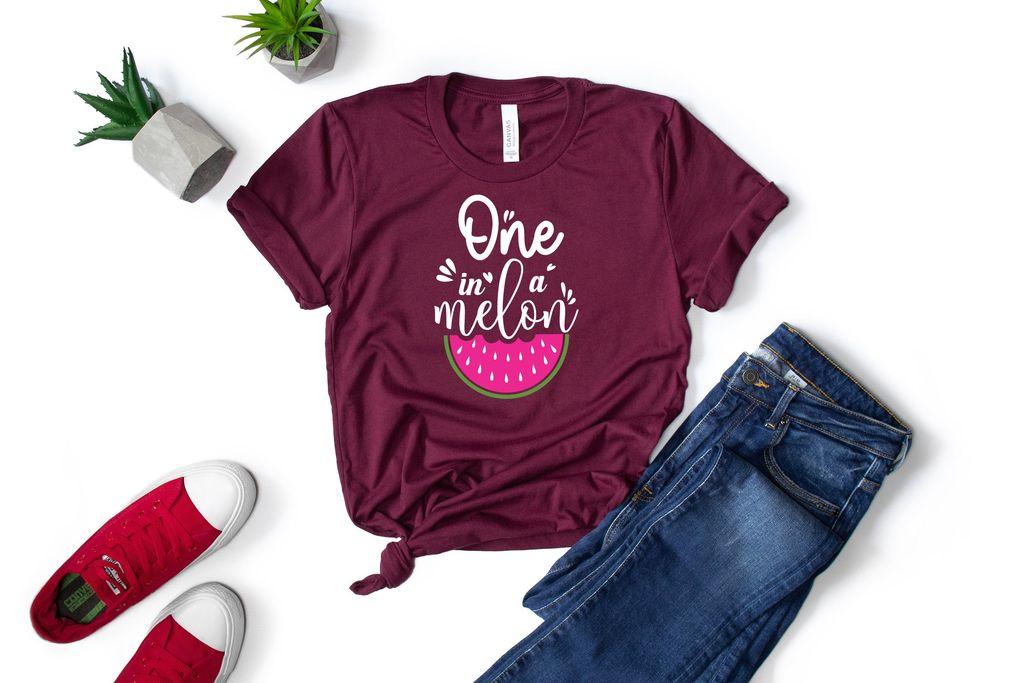 Dark jeans and a burgundy slogan T-shirt.