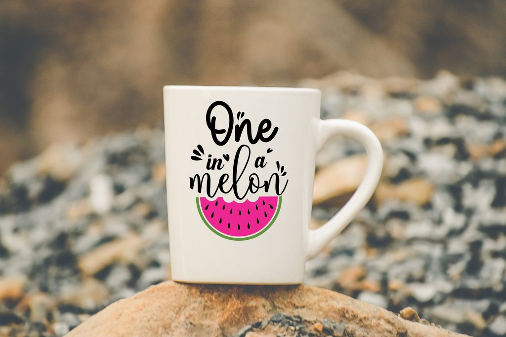 A cup on a stone and an inscription about a watermelon on it.