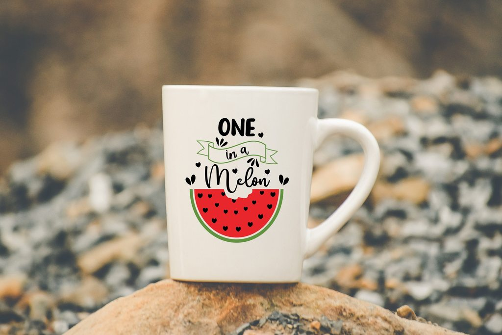 White cup with a picture of a watermelon and a thematic inscription.