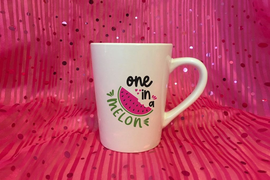 Pink glittering background with a cup with watermelon on it.
