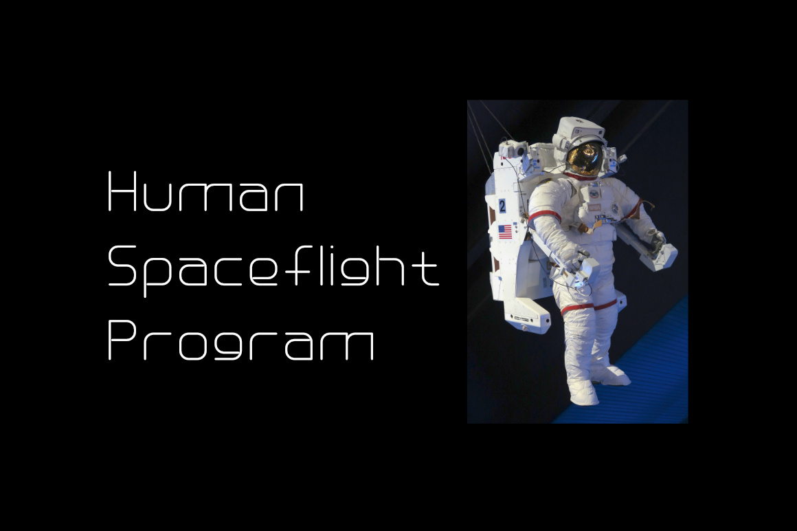 An astronaut in his special suit hovers in space.