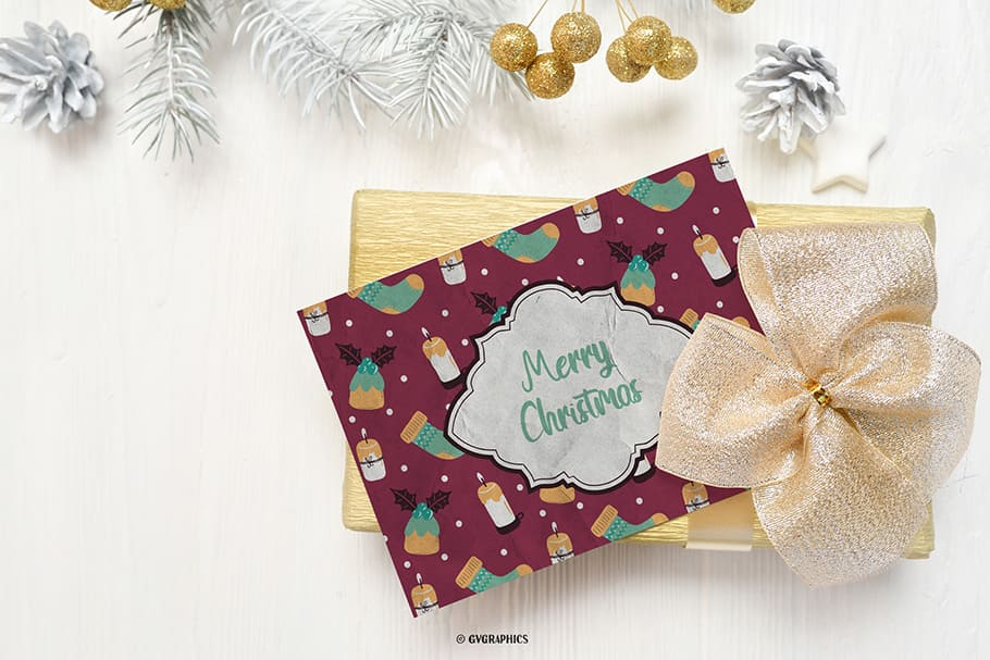 Burgundy card with traditional holiday candles and socks with gifts.