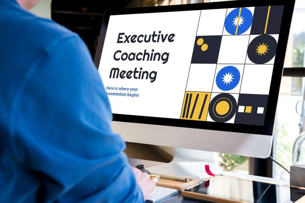Desktop Mockup Executive Coaching Meeting Powerpoint Template.